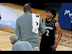 Georgetown's Dante Harris (2) celebrates with coach Patrick Ewing after the team's NCAA college basketball game against Seton Hall in the semifinals in the Big East men's tournament Friday, March 12, 2021, in New York.
