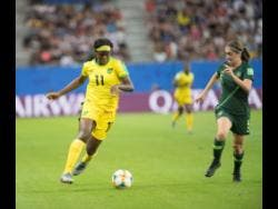 Khadija Shaw (left) dribbles away from Australia's defender Karly Roestbakken during their first-round match in the 2019 FIFA Women's World Cup at Stade des Alpes in Grenoble, France, on Tuesday June 18.