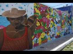 One of the murals adding some colour to communities in Central Kingston. This one is on Water Lane.
