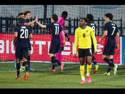 US players celebrate after scoring their second goal during the international friendly soccer match between USA and Jamaica at SC Wiener Neustadt stadium in Wiener Neustadt, Austria, Thursday, March 25, 2021.