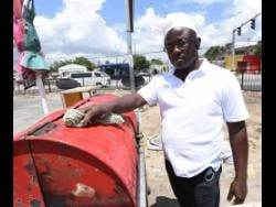 Verol Scarlett, a pan chicken vendor who operates from the Naggo Head taxi stand in Portmore, St Catherine.