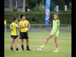 Reggae Girlz (from left) Lauren Silver, Marlo Sweatman, and Sydney Schneider in discussion during a training session at Stade Eugene Thenard in Grenoble, France, on Monday, June 17, 2019.