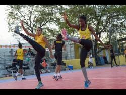Sunshine Girls Adean Thomas (left) and Nichole Dixon go through their paces during a training session at the Leila Robinson Courts at the National Stadium on Wednesday, June 5, 2019.