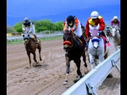 Pure Heart (on rails), ridden by Youville Pinnock, on his way to victory at Caymanas Park on Wednesday, April 7.