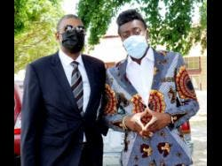 Beenie Man (right) outside the courthouse with his lawyer Roderick Gordon.