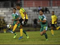 File Jamaica's Peter-Lee Vassell attempts to control the ball while being pursued by Guyana's Samuel Cox during their Concacaf Nations League's match at the Montego Bay Sports Complex in 2019.