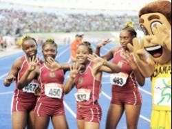 Members of the Holmwood Technical High School team, along with 'Champsy',  celebrate  at the ISSA/GraceKenedy Boys and Girls' Athletics Championships in 2011.