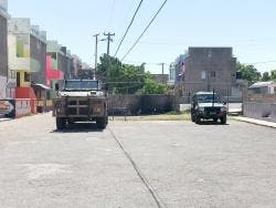Military vehicles parked at Site, a section of the violence-prone Dunkirk community.