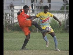 Tivoli Gardens' Jabeur Johnson (left) tackles Waterhouse player Colorado Murray in their Jamaica Premier League encounter at the Edward Seaga Sports Complex in December 2019.