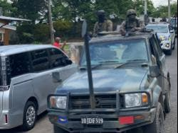 Members of the Jamaica Defence Force and Jamaica Constabulary Force in the Comfort district on patrol recently.