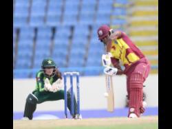 West Indies Women's Hayley Matthews (right) in action against Pakistan Women in their first of three Twenty20 International matches in Antigua yesterday.