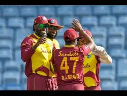 West Indies players celebrate the fall of a South African wicket during yesterday's fourth T20 International in Grenada.