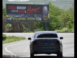 This billboard located at the intersection of Lakes Pen Road and Municipal Boulevard in Portmore, St Catherine, one of three mounted to warn Sunday worshippers about the Mark of the Beast.