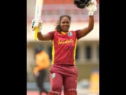 West Indies Women's opener Hayley Matthews celebrates her century  against Pakistan in Antigua yesterday.