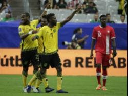 Jamaica's Romario Williams (left) is congratulated by his team-mates after he scored his team's second goal against Canada during a CONCACAF Gold Cup quarter-final match on July 20, 2017, in Glendale, Arizona.