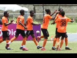 Members of Tivoli Gardens' Jamaica Premier League team celebrate their goal against Vere United during last Saturday's match at the UWI-JFF Captain Horace Burrell Centre of Excellence.