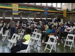 Persons at the National Arena waiting to be vaccinated.