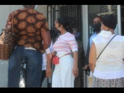 Jayda Cheaves(centre) leaves the Western Regional Gun Court in Montego Bay, St James, on Wednesday. Cheaves and Gregory Wright, a member of her entourage, were before the court to answer to charges of illegal possession of firearm and ammunition, following their arrest on Monday while boarding a private jet at the Sangster International Airport in Montego Bay. The two were fined a combined $1.6 million after pleading guilty.