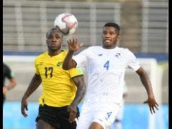 Jamaica's Michail Antonio (left) challenges Panama's Fidel Escobar for the ball during their Concacaf  World Cup Qualifying match at the National Stadium on Sunday, September 5.