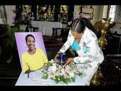 Jhanine Jackson places the urn with Karen Smith's remains after she was cremated.