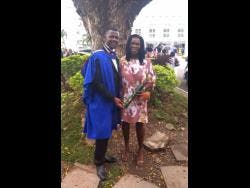 Jadio Dennis and his mother Ruby Gordon at his graduation from Shortwood Teachers' College.