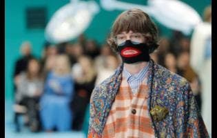 FILE   A model wears a creation as part of the Gucci women's Fall/Winter 2018-2019 collection, presented during Milan Fashion Week in Milan, Italy. Gucci, which designed this face warmer reminiscent of blackface, received instant backlash from the public and was forced to apologise publicly earlier this month.