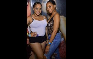 Anthony Minott Jhanaye (left) and Donique make a pretty pair. They were out at Liquid Spiritz, held at Pulse 8 recently.
