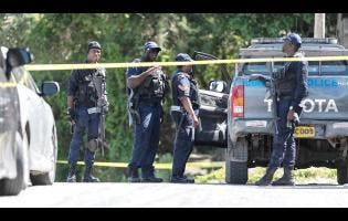 Gladstone Taylor Photos Cops were out in their numbers following the shooting in Goldsmith Villa, St Andrew, yesterday.