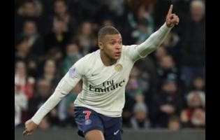 AP PSG forward Kylian Mbappe celebrates after scoring the opening goal during the French League One match between Saint-Etienne and Paris Saint-Germain at the Geoffroy Guichard stadium in Saint-Etienne, central France, yesterday.