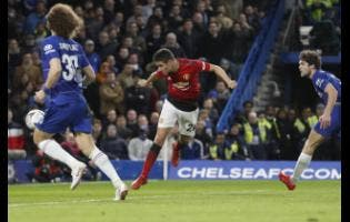 AP Manchester United's Ander Herrera (centre) scores the opening goal of the game during the English FA Cup fifth-round match between Chelsea and Manchester United at Stamford Bridge stadium in London, yesterday. United won 2-0.