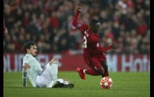 Bayern defender Mats Hummels (left) competes for the ball with Liverpool's Naby Keita during the Champions League round-of-16 first-leg match at Anfield yesterday. The match ended 0-0.