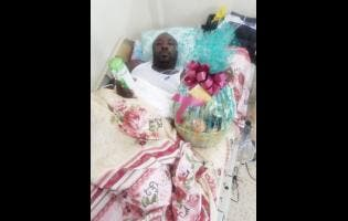 Police Constable Kemar Brown recovering in hospital.