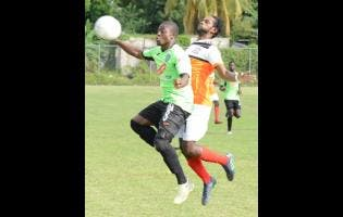 Ian Allen Tivoli Gardens FC's Shavar Campbell (left) tries to take the ball on his chest, while being pressured by Dunbeholden FC's Shevan James during a Red Stripe Premier League match at Royal Lakes in St Catherine, on Sunday, February 3, 2019.