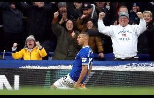 Everton's Richarlison celebrates scoring his side's first goal of the game,  during the English Premier League match between Everton and Chelsea at Goodison Park in Liverpool, England, yesterday.