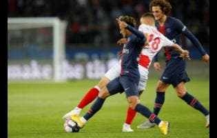 AP In this file picture PSG's Neymar (left) fights for the ball with Reims' Remi Oudin during the French League One match between Paris-Saint-Germain and Reims at the Parc des Princes stadium in Paris, France.