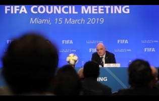 ap FIFA President Gianni Infantino listens to a question from a member of the media during a press conference after a FIFA Council Meeting, on Friday, March 15, 2019, in Miami.