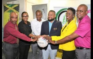 Principals pose for a photo at the sponsorship announcement for Netball Jamaica's Major and Minor Leagues, at Olympic Manor, Jamaica Olympic Association (JOA) headquarters, last Thursday. They are (from left) Christopher Samuda, President, JOA, Starlight Productions' Lisa Spence, Omar Palmer, Consumer Distributors Manager, LASCO, Ryan Foster, General Secretary, JOA, Dr Paula Daley Morris, President, Netball Jamaica and Gary Cole, Marketing Consultant, LASCO.