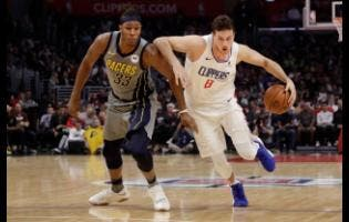 Los Angeles Clippers' Danilo Gallinari (8) dribbles past Indiana Pacers' Myles Turner (33) during the first half of an NBA basketball game on Tuesday night.