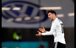 AP Germany's Leon Goretzka celebrates after scoring his side's opening goal during an international friendly match between Germany and Serbia at the Volkswagen Arena stadium in Wolfsburg, Germany, yesterday.
