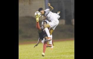 Cavalier's Alex Marshall (right) and Arnett Gardens' Tamar Edwards battle for possession during a Red Stripe Premier League game at Stadium East field on Thursday, November 23, 2017.