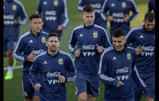 Argentina's Lionel Messi (bottom left) and teammates during a training session in Madrid, Spain, on Monday.