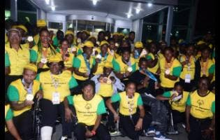 Members of Jamaica's Special Olympic Team to the World games in Abu Dhabi return to Jamaica early yesterday morning  at the Norman Manley International Airport  after winning a record 33 medals.
