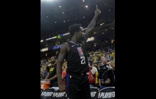 Los Angeles Clippers guard Patrick Beverley celebrates during the second half of Game 2 of a first-round NBA basketball play-off series against the Golden State Warriors in Oakland, California, on Monday, April 15.