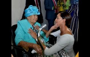Member of Parliament for East Portland Ann-Marie Vaz shares a touching moment with her grandmother, Eva May Wright,  before she was sworn in as the new MP.