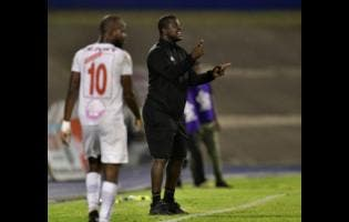 Portmore United head coach Shavar Thomas (right) shouts instructions to his team during the second leg of their Red Stripe Premier League semi-final clash with Mount Pleasant FA at the National Stadium in Kingston, on Monday.