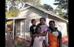 Cassandra Francis is happy to have a safe home for her family. Joining her for a photo are her 18-year-old son (right), eight-year-old daughter (front) and her two-year-old daughter.