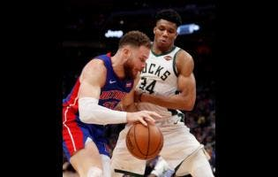 Detroit Pistons forward Blake Griffin is defended by Milwaukee Bucks forward Giannis Antetokounmpo (34) during the second half of Game 4 of a first-round NBA basketball playoff series on Monday.