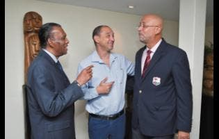 Cricket West Indies president Ricky Skerritt (right) shares a light moment with Jamaica Cricket Association president W. Billy Heaven (left) and Group CEO, GraceKennedy and chairman of CWI's Corporate Governance Committee, Senator Don Wehby, after a high-level meeting at the Terra Nova All-Suite Hotel on Wednesday, April 17.