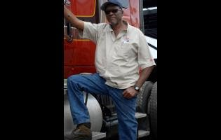 Lionel Rookwood/Photographer  Lenon 'Puppy' Williams has been with Zoukie Trucking for more than 25 years.