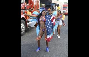 A reveller enjoys herself during Carnival Road March last year.